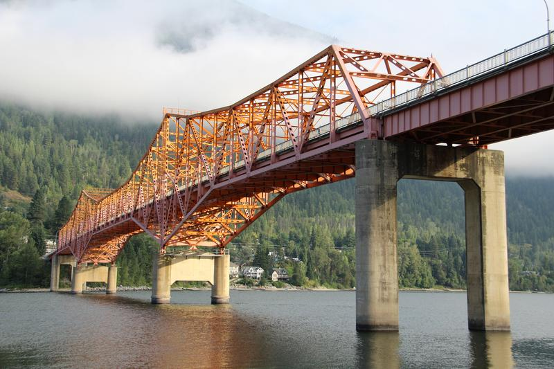 Nelson Bridge on BC-3A over the Kootenay River in Nelson, Central Kootenay District, British Columbia.Photographed by Flickr user C Hancheyhttps://www.flickr.com/photos/21953562@N07/17346903312/in/photolist-sqTpZS-8ybB8w-8y8yv6-soFR6J-soFUCd-sqPjad-LqMcS7-L3ko4C-cor31G-LtKhrn-9Qs611-9PY4GR-9jLjwy-6YAdBw-6sDqxu-8f4hYg-9Qsa3m-Z8epb-75Eujv-6Wrnvo-6YwjTe-6REaE8-6Q3PCG-7ffNQs-9Qs7Yf-9Q1T8h-7cYLwF-74UpK1-6WrAWh-6Ts9TE-58h5BX-4wr7L9-4ws9aL-c7LHco-9Qs9B3-8WZZwq-7fbVEv-74Qvar-6WrHBv-6WrN6V-6WvJay-6PDEbX-6Q3S8y-dXRa1d-FFxEkA-9PY5vV-Z3czz-7ffNBh-7cZoTZ-6XA9pa